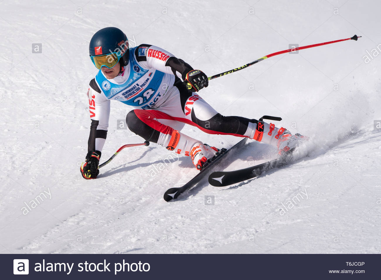 KAMCHATKA PENINSULA, RUSSIA - APR 1, 2019: Mountain skier Egor Sazonov (Kamchatka Krai) skiing down mount slope. Russian Alpine Skiing Cup, Internatio - Stock Image