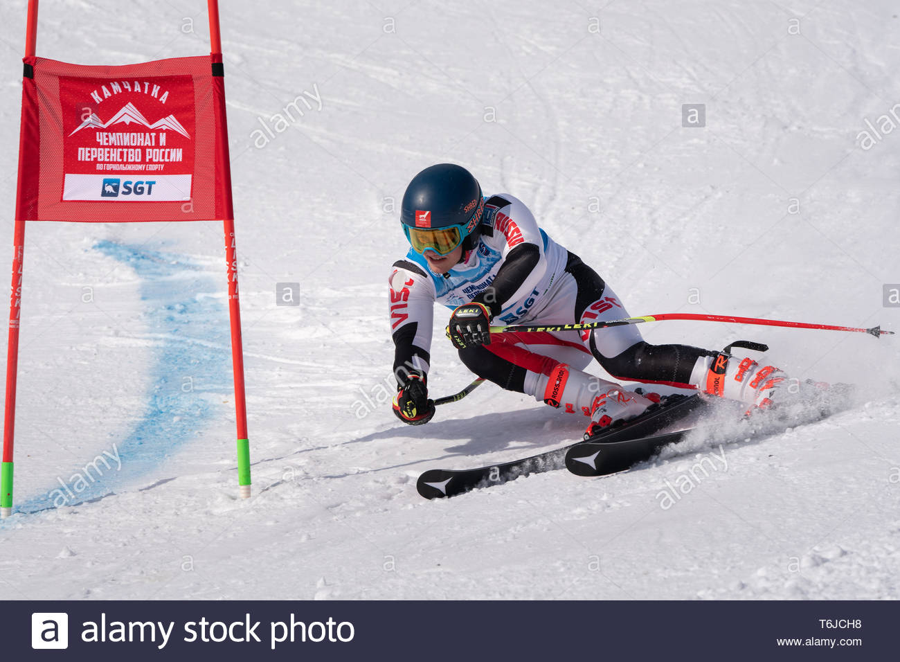 KAMCHATKA PENINSULA, RUSSIA - APR 1, 2019: Russian Alpine Skiing Cup, International Ski Federation (FIS) Championship, giant slalom. Mount skier Egor  - Stock Image