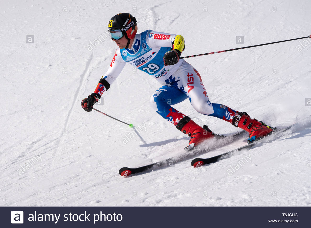 KAMCHATKA PENINSULA, RUSSIA - APR 1, 2019: Mountain skier Kablukov Konstantin (Kamchatka) skiing down slope. Russian Alpine Skiing Cup, International  - Stock Image