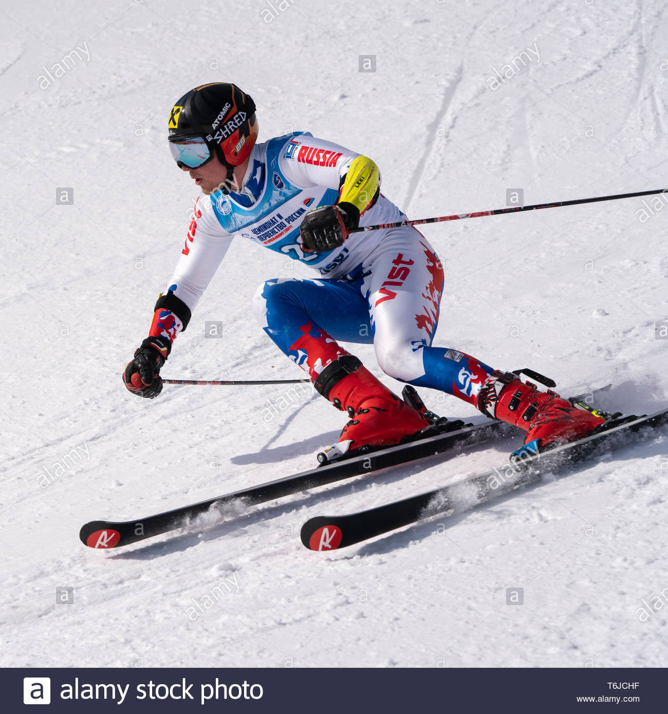 KAMCHATKA PENINSULA, RUSSIA - APR 1, 2019: Russian Alpine Skiing Cup, International Ski Federation (FIS) Championship, giant slalom. Mount skier Kablu - Stock Image