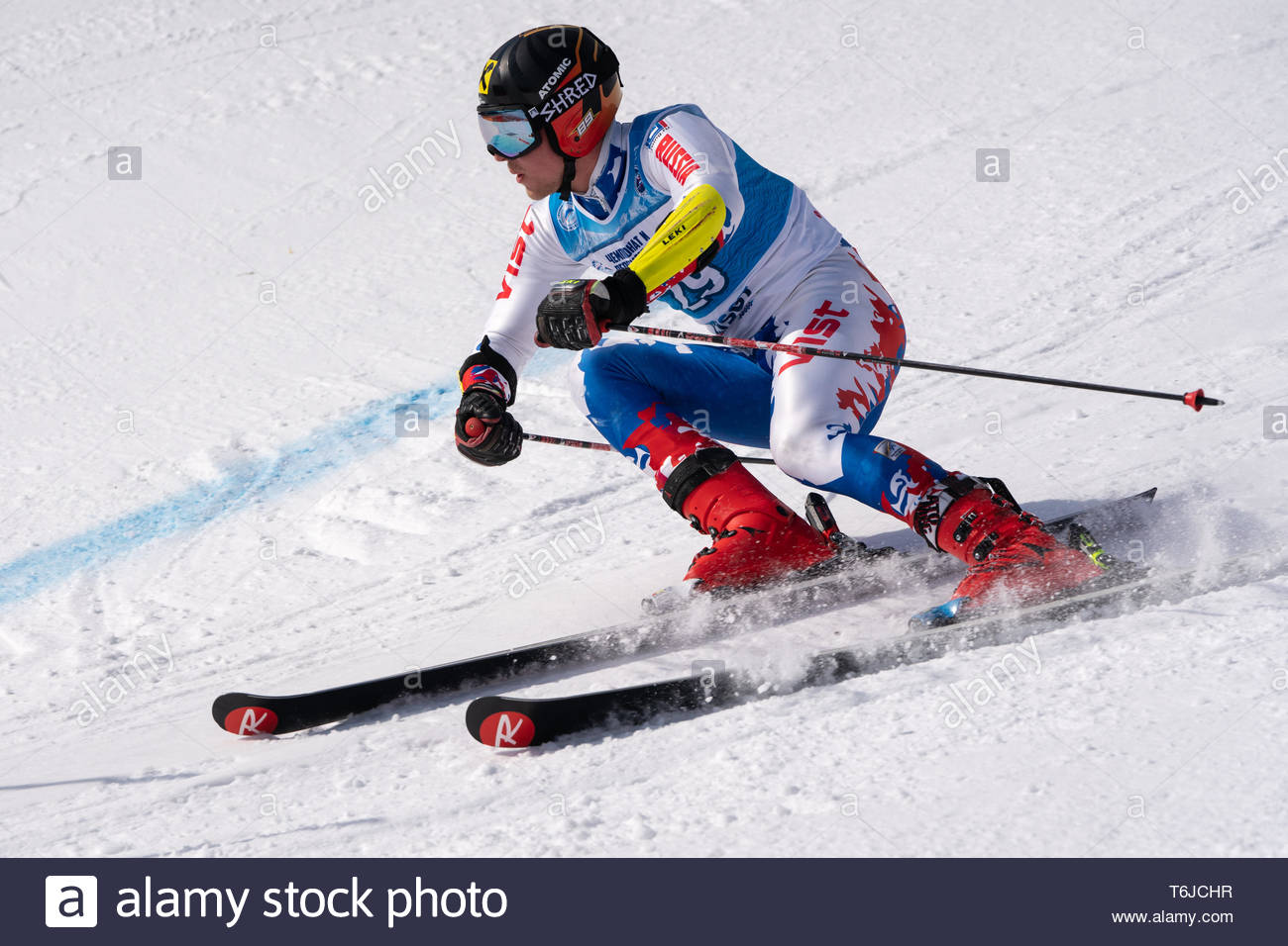KAMCHATKA PENINSULA, RUSSIA - APR 1, 2019: Mountain skier Konstantin Kablukov (Kamchatka) skiing down slope. Russian Alpine Skiing Cup, International  - Stock Image