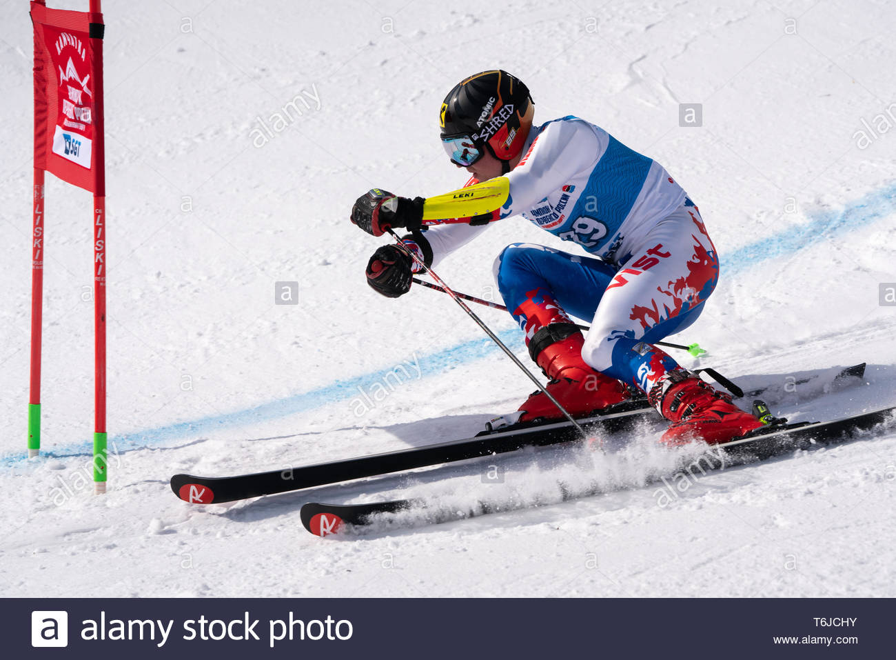 KAMCHATKA PENINSULA, RUSSIA - APR 1, 2019: Russian Alpine Skiing Cup, International Ski Federation (FIS) Championship, giant slalom. Mount skier Konst - Stock Image