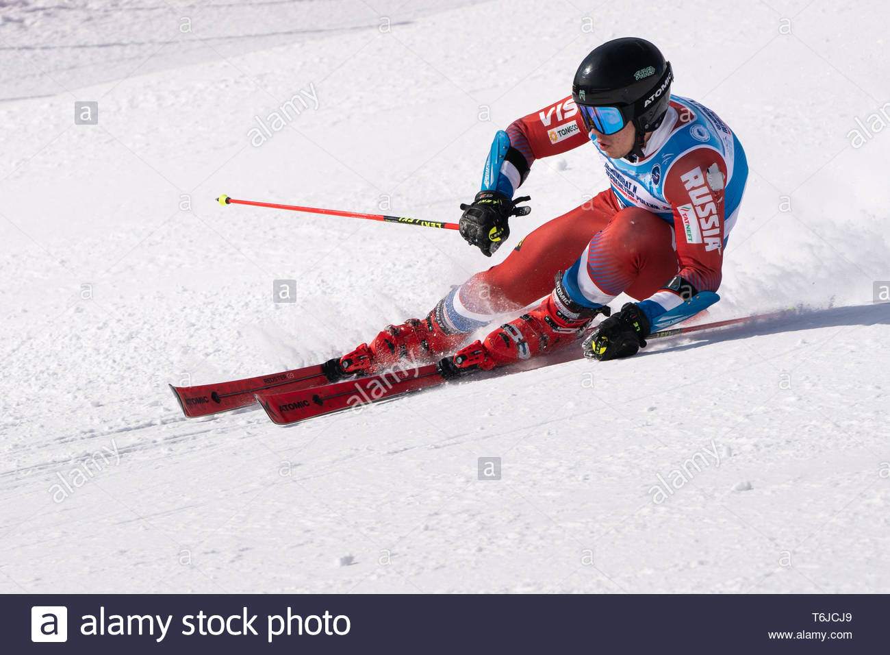 KAMCHATKA PENINSULA, RUSSIA - APR 1, 2019: Mountain skier Alexander Mikhailov (Sakhalin) skiing down slope. Russian Alpine Skiing Cup, International S - Stock Image