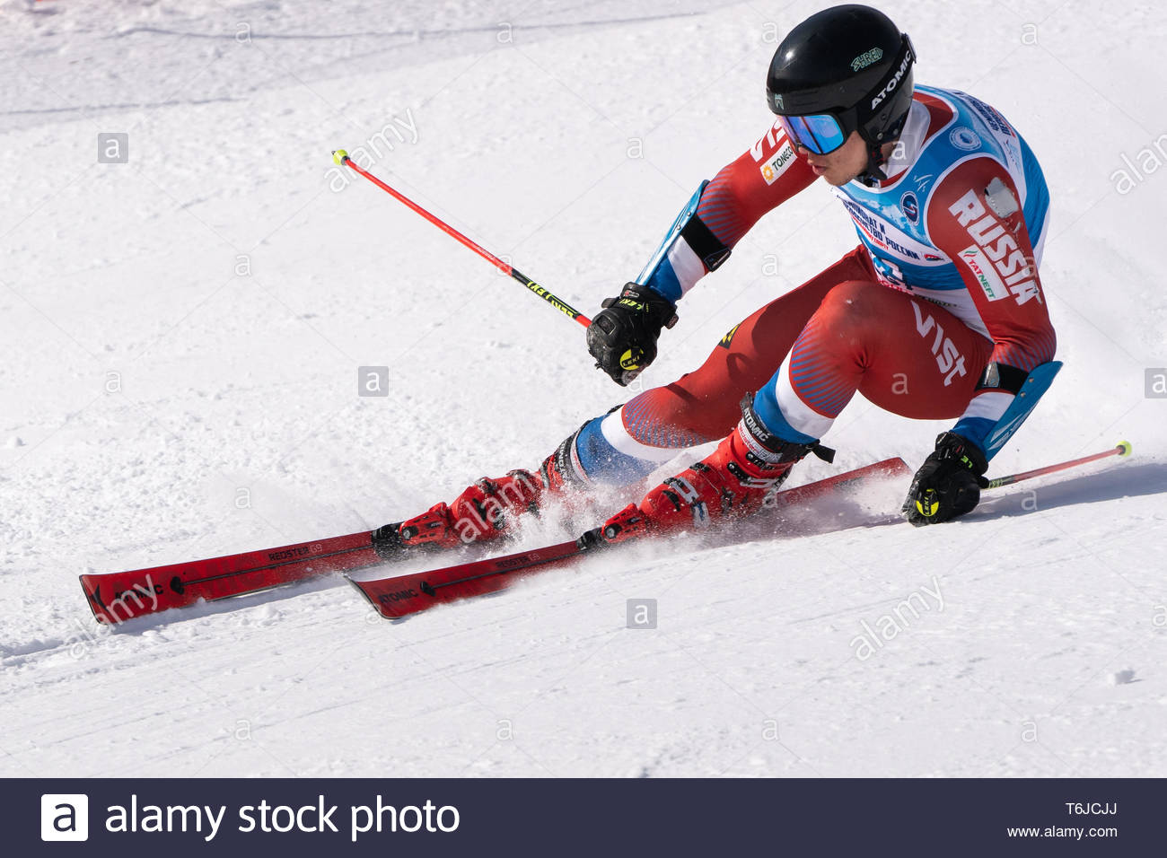 KAMCHATKA PENINSULA, RUSSIA - APR 1, 2019: Russian Alpine Skiing Cup, International Ski Federation (FIS) Championship, giant slalom. Mount skier Mikha - Stock Image