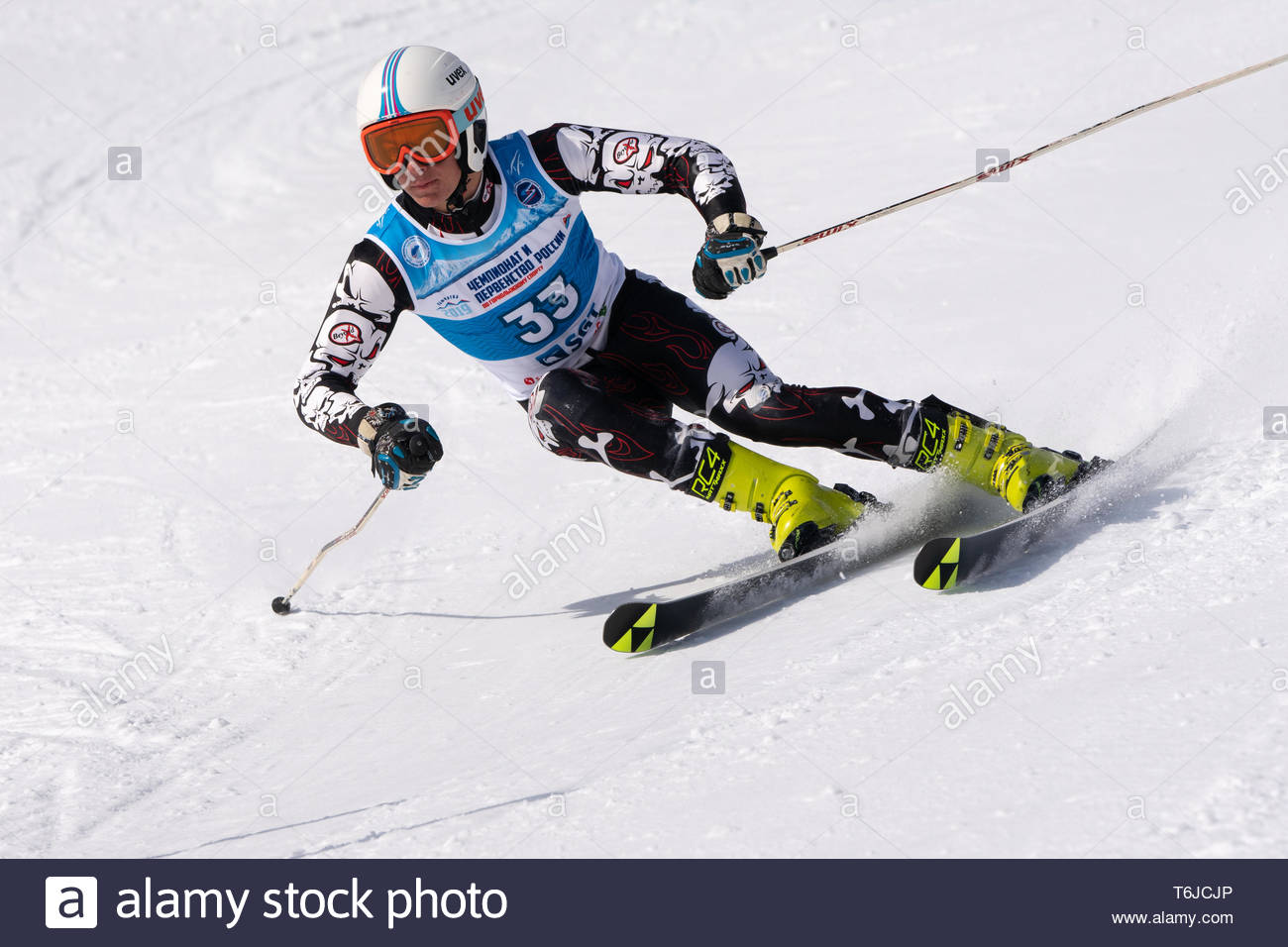 KAMCHATKA PENINSULA, RUSSIA - APR 1, 2019: Mountain skier Zhuravchenko Stepan (Krasnodar) skiing down slope. Russian Alpine Skiing Cup, International  - Stock Image
