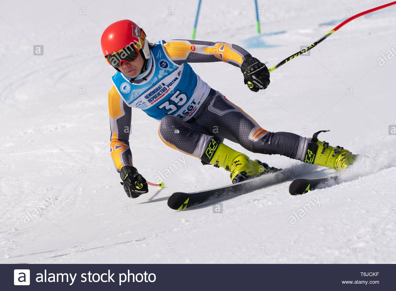 KAMCHATKA PENINSULA, RUSSIA - APR 1, 2019: Mountain skier Danila Tenishev (Moscow) skiing down mount slope. Russian Alpine Skiing Cup, International S - Stock Image