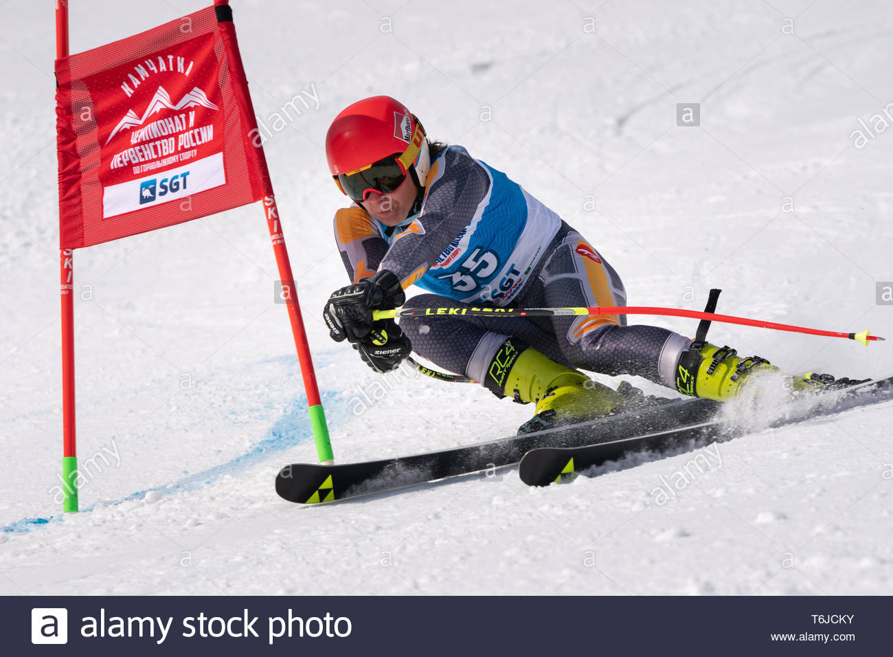 KAMCHATKA PENINSULA, RUSSIA - APR 1, 2019: Mountain skier Tenishev Danila (Moscow) skiing down mount slope. Russian Alpine Skiing Cup, International S - Stock Image