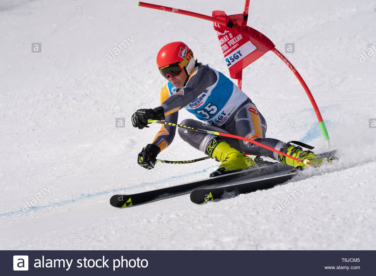 KAMCHATKA PENINSULA, RUSSIA - APR 1, 2019: Russian Alpine Skiing Cup, International Ski Federation (FIS) Championship, giant slalom. Mountain skier Da - Stock Image