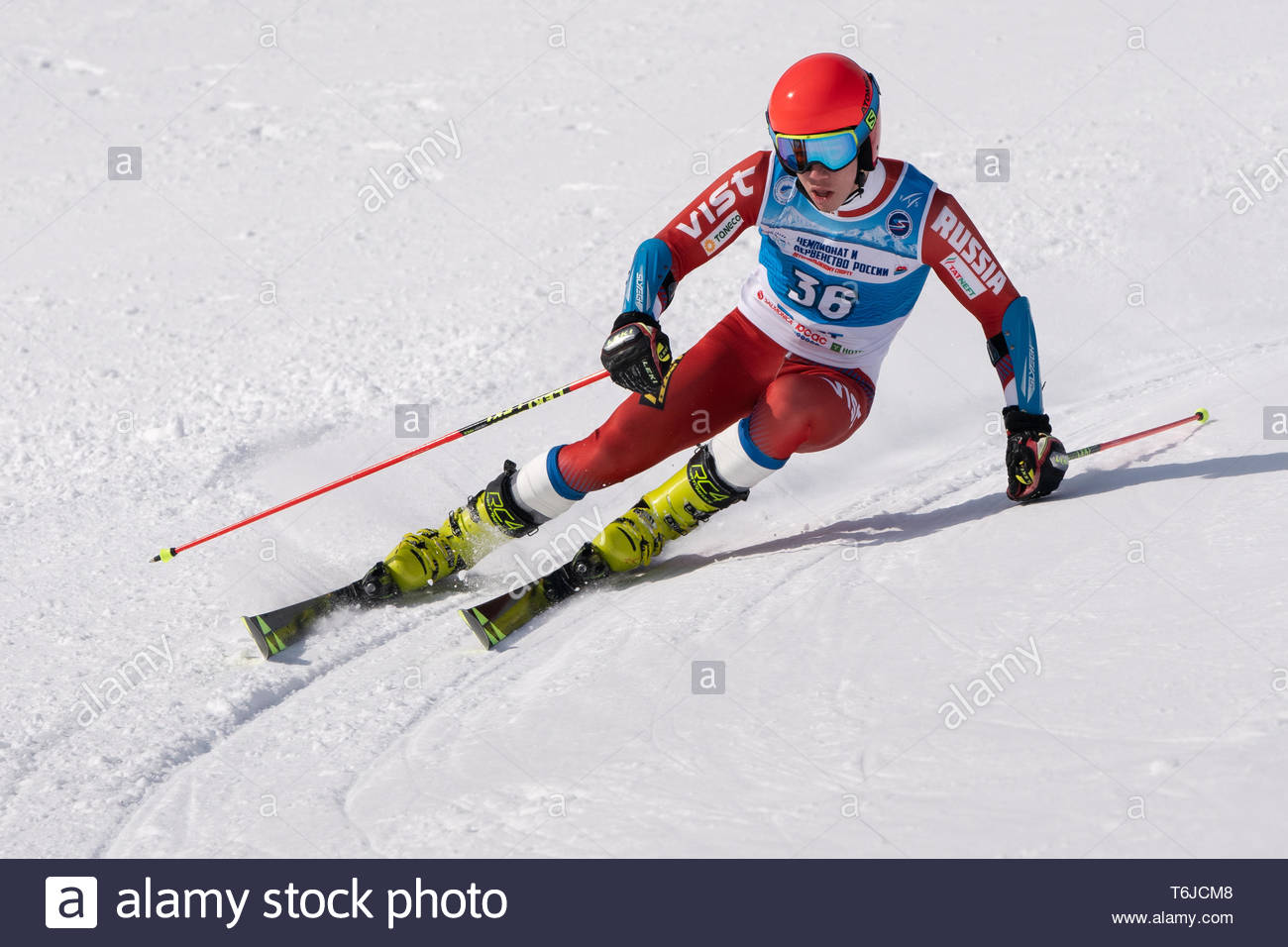 KAMCHATKA PENINSULA, RUSSIA - APR 1, 2019: Russian Alpine Skiing Cup, International Ski Federation (FIS) Championship, giant slalom. Mountain skier Na - Stock Image