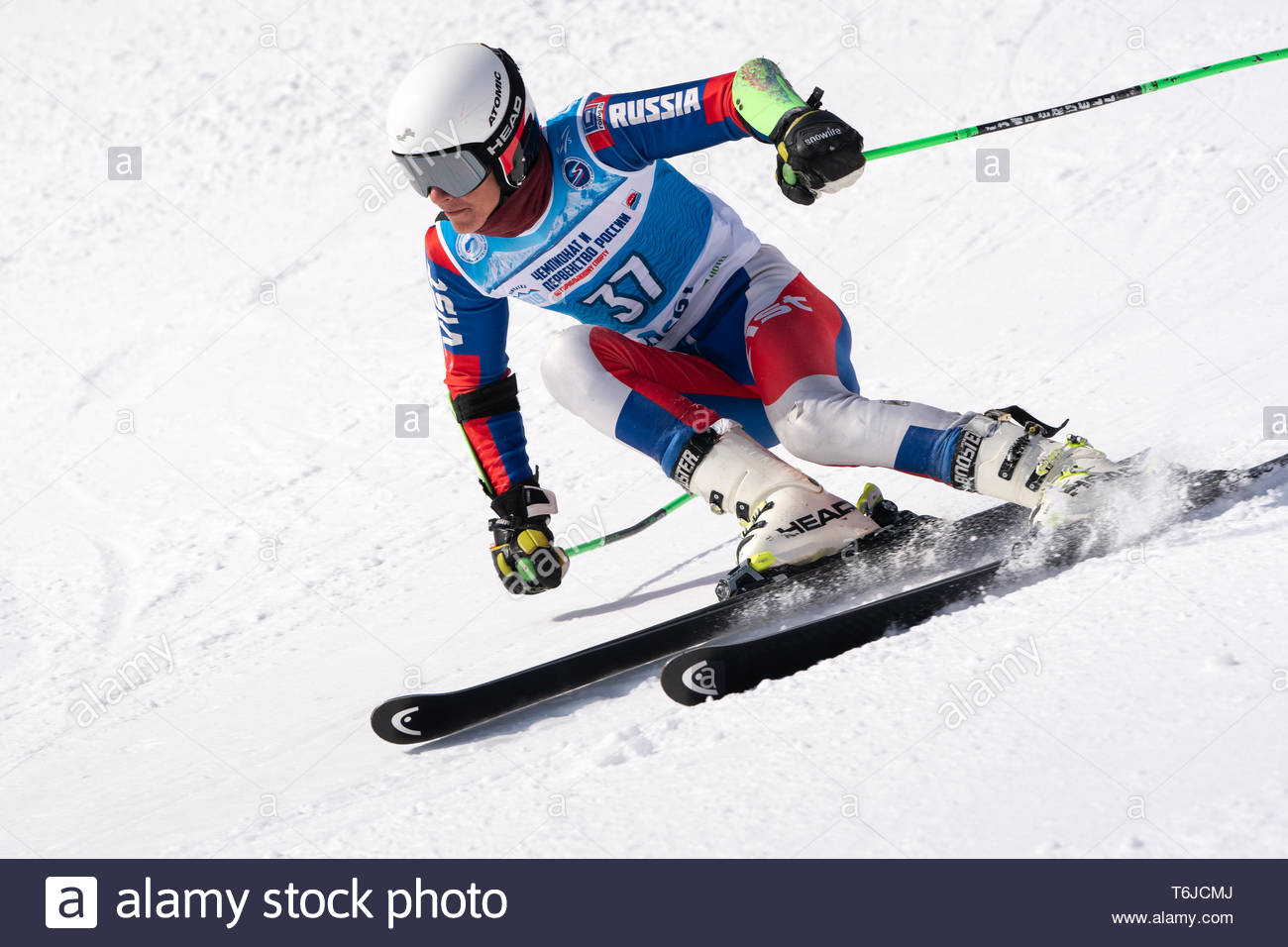 KAMCHATKA PENINSULA, RUSSIA - APR 1, 2019: Mountain skier Dzhioev Kirill (Magadan) skiing down mount slope. Russian Alpine Skiing Cup, International S - Stock Image