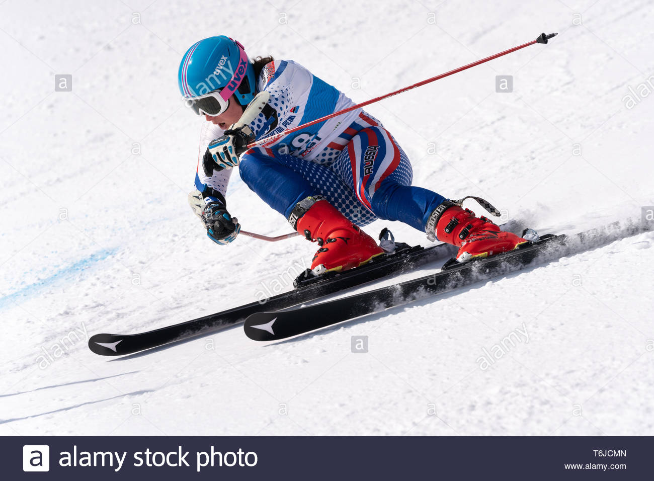 KAMCHATKA PENINSULA, RUSSIA - APR 1, 2019: Mountain skier Kozhevnikov Denis (St. Petersburg) skiing down mount. Russian Alpine Skiing Cup, Internation - Stock Image
