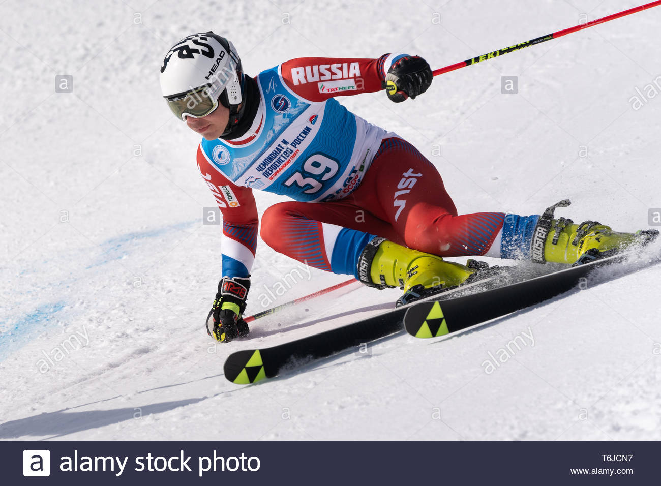 KAMCHATKA PENINSULA, RUSSIA - APR 1, 2019: Mountain skier Popov Nikolay (Sverdlovsk Region) skiing down mount. Russian Alpine Skiing Cup, Internationa - Stock Image