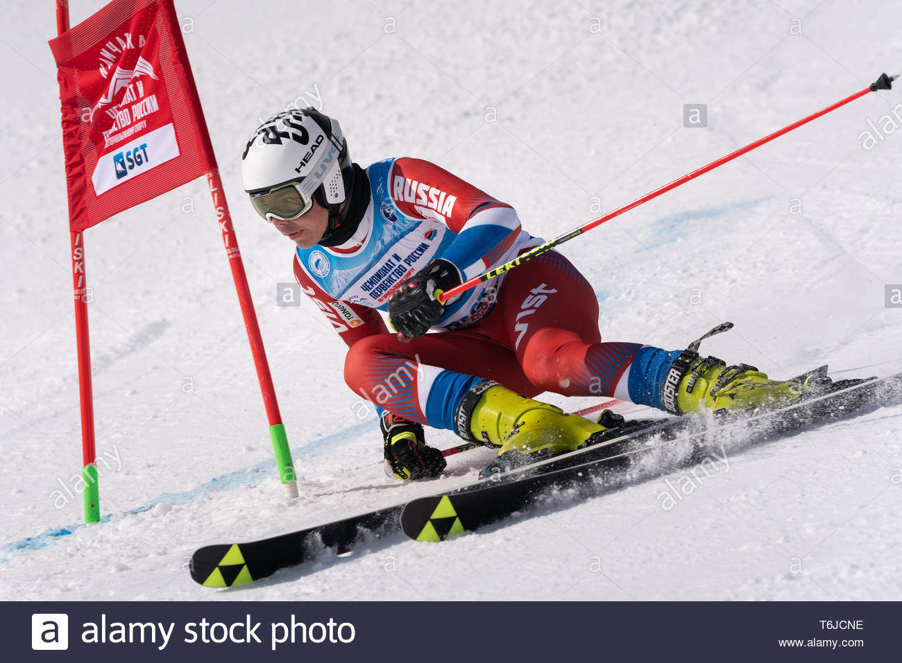 KAMCHATKA PENINSULA, RUSSIA - APR 1, 2019: Russian Alpine Skiing Cup, International Ski Federation (FIS) Championship, giant slalom. Mountain skier Ni - Stock Image