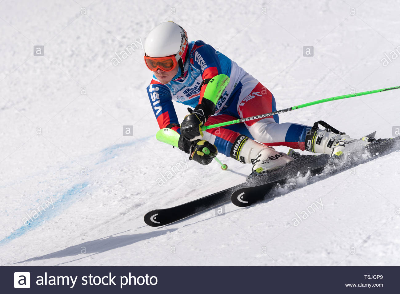 KAMCHATKA PENINSULA, RUSSIA - APR 1, 2019: Russian Alpine Skiing Cup, International Ski Federation (FIS) Championship, giant slalom. Mountain skier Bu - Stock Image