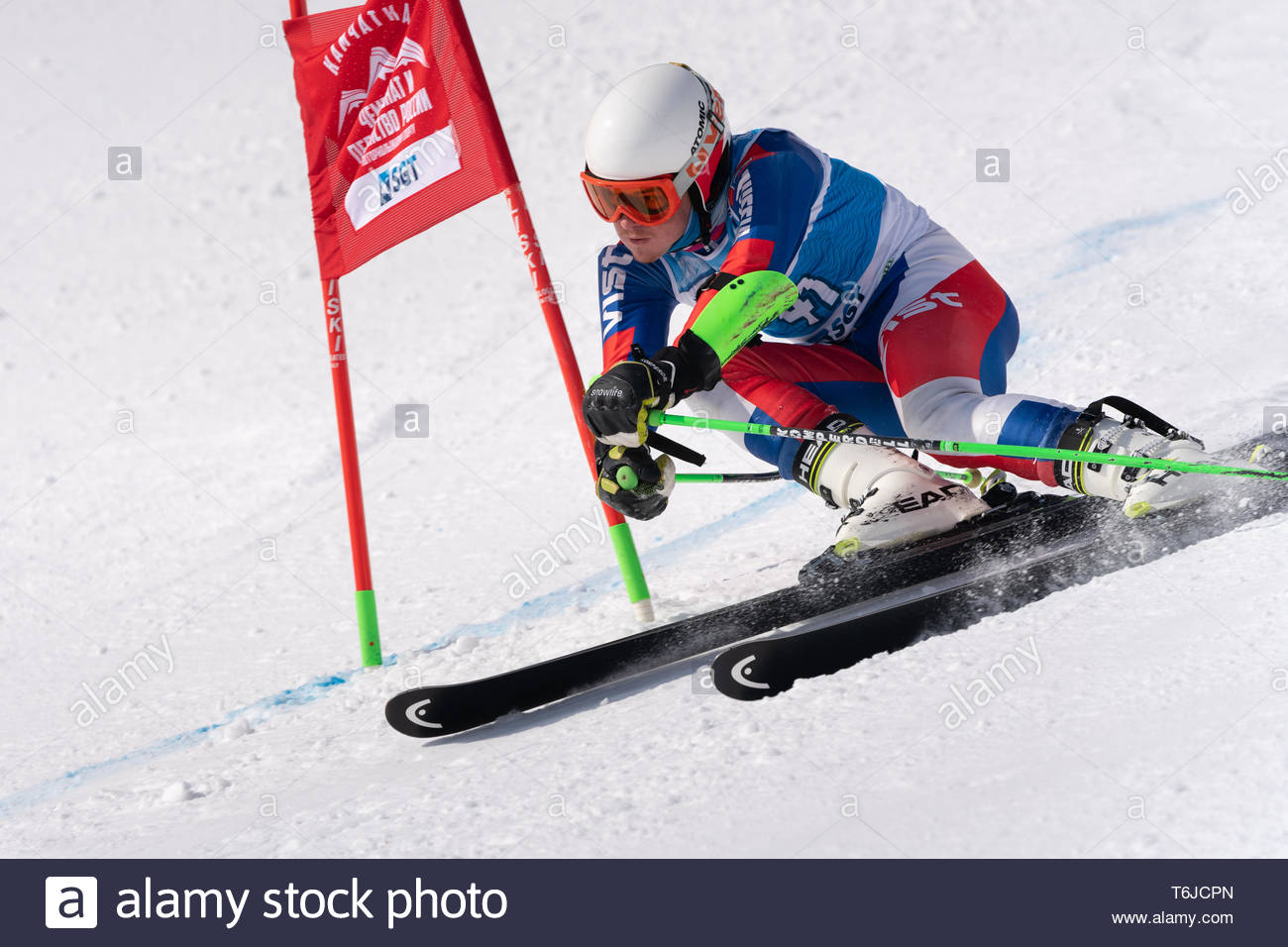 KAMCHATKA PENINSULA, RUSSIA - APR 1, 2019: Mountain skier Burmistrov Eugene (Magadan) skiing down mount slope. Russian Alpine Skiing Cup, Internationa - Stock Image