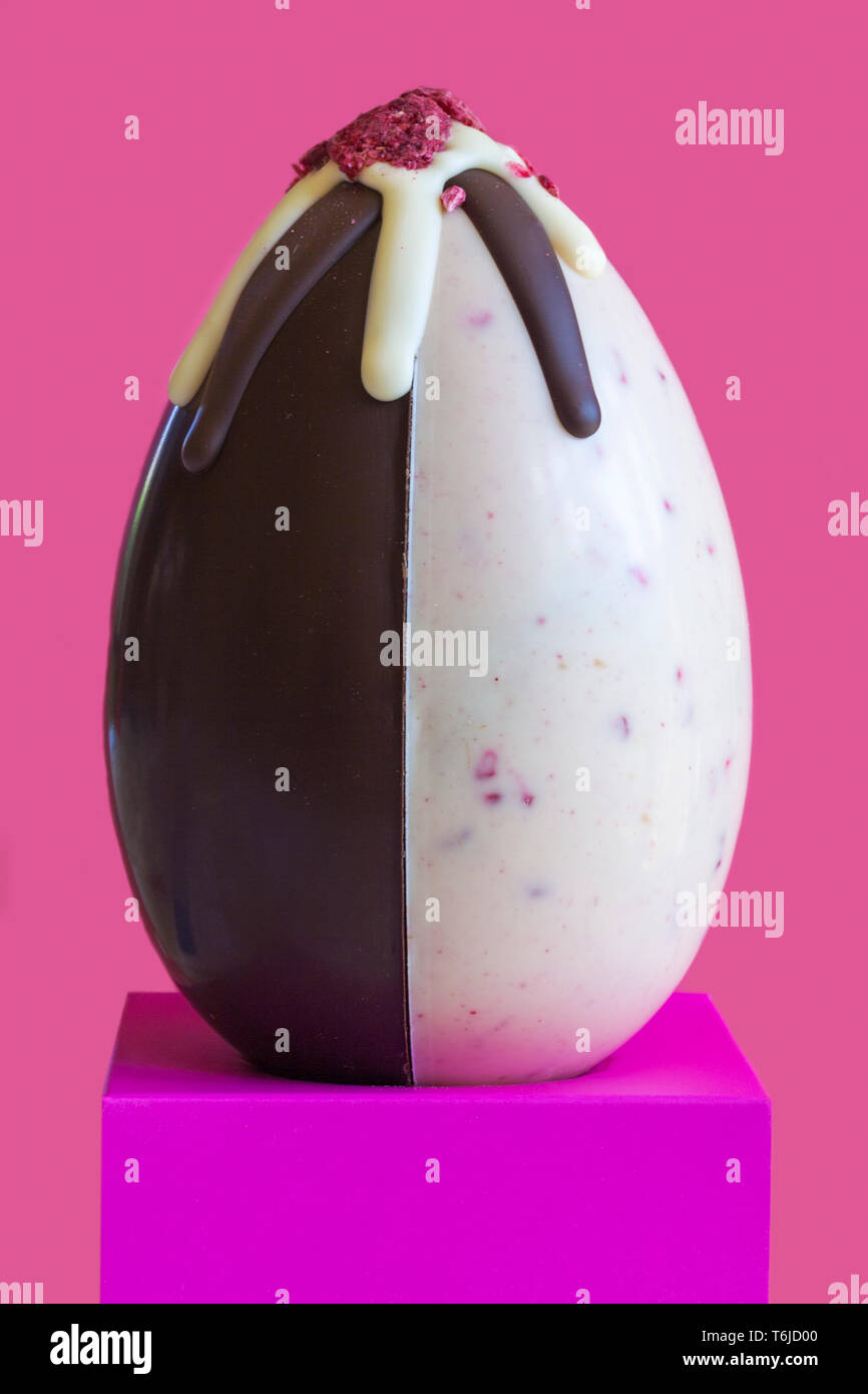 Waitrose hand decorated Scottish raspberry chocolate Easter Egg - an indulgent white and dark chocolate egg with freeze dried raspberry pieces - Stock Image
