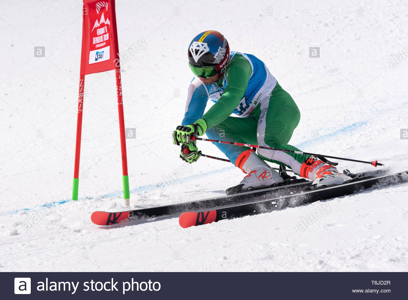 KAMCHATKA PENINSULA, RUSSIAN FAR EAST - APR 1, 2019: Mountain skier Tukhtaev Komiljon (Republic Uzbekistan) skiing down mountain slope. International  - Stock Image
