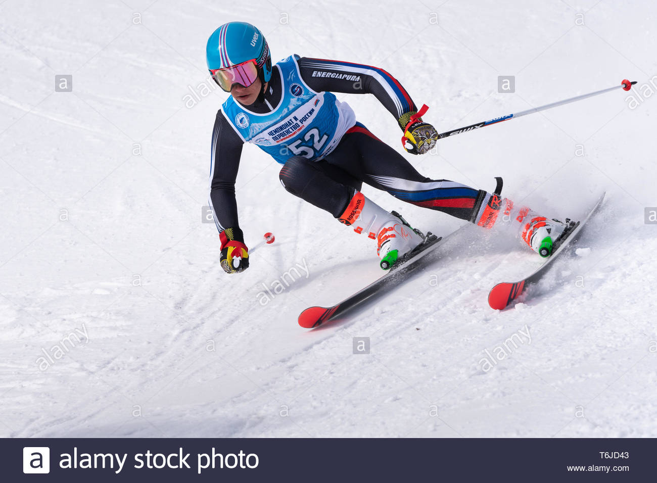 KAMCHATKA PENINSULA, RUSSIA - APR 1, 2019: Mountain skier Sitchikhin Maxim (Kamchatka) skiing down mount slope. Russian Alpine Skiing Cup, Internation - Stock Image