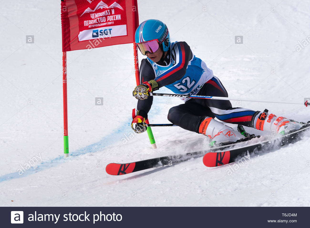 KAMCHATKA, RUSSIA - APR 1, 2019: Mountain skier Maxim Sitchikhin (Kamchatka Peninsula) skiing down mount slope. Russian Alpine Skiing Cup, Internation - Stock Image