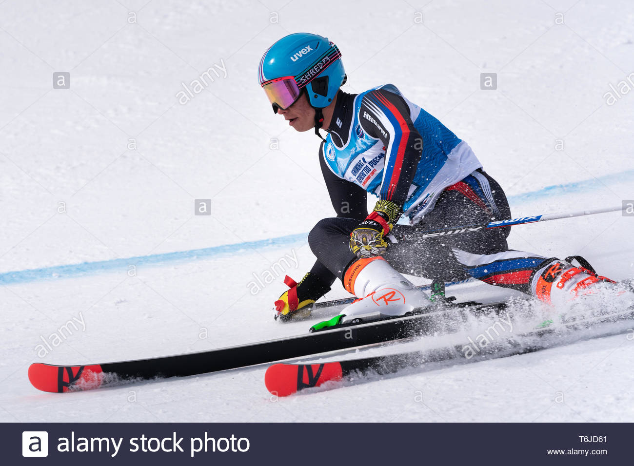 KAMCHATKA PENINSULA, RUSSIA - APR 1, 2019: Mountain skier Maxim Sitchikhin (Kamchatka) skiing down mount slope. Russian Alpine Skiing Cup, Internation - Stock Image
