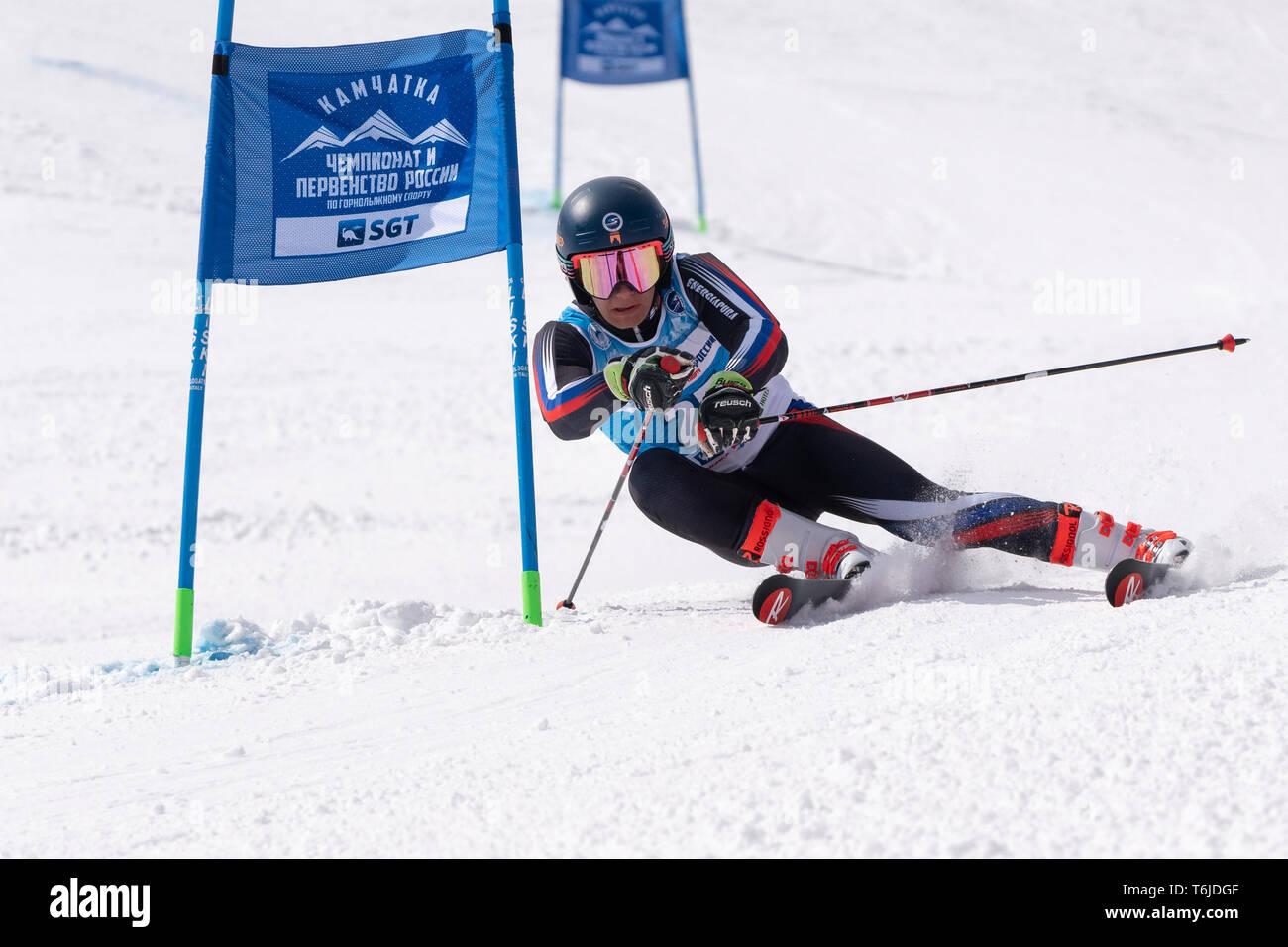 KAMCHATKA PENINSULA, RUSSIA - APRIL 1, 2019: Mountain skier Svitkov Gennady (Kamchatka) skiing down mountain slope. Russian Alpine Skiing Cup, Interna Stock Photo