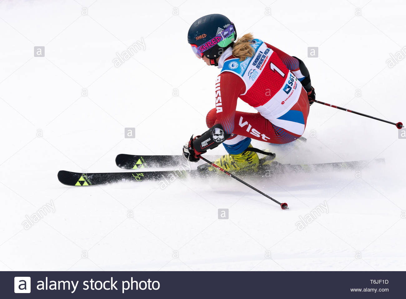 KAMCHATKA, RUSSIA - APRIL 2, 2019: Mountain skier Kryukova Kristina (Kamchatka Peninsula) skiing down mount. International Ski Federation, Championshi - Stock Image