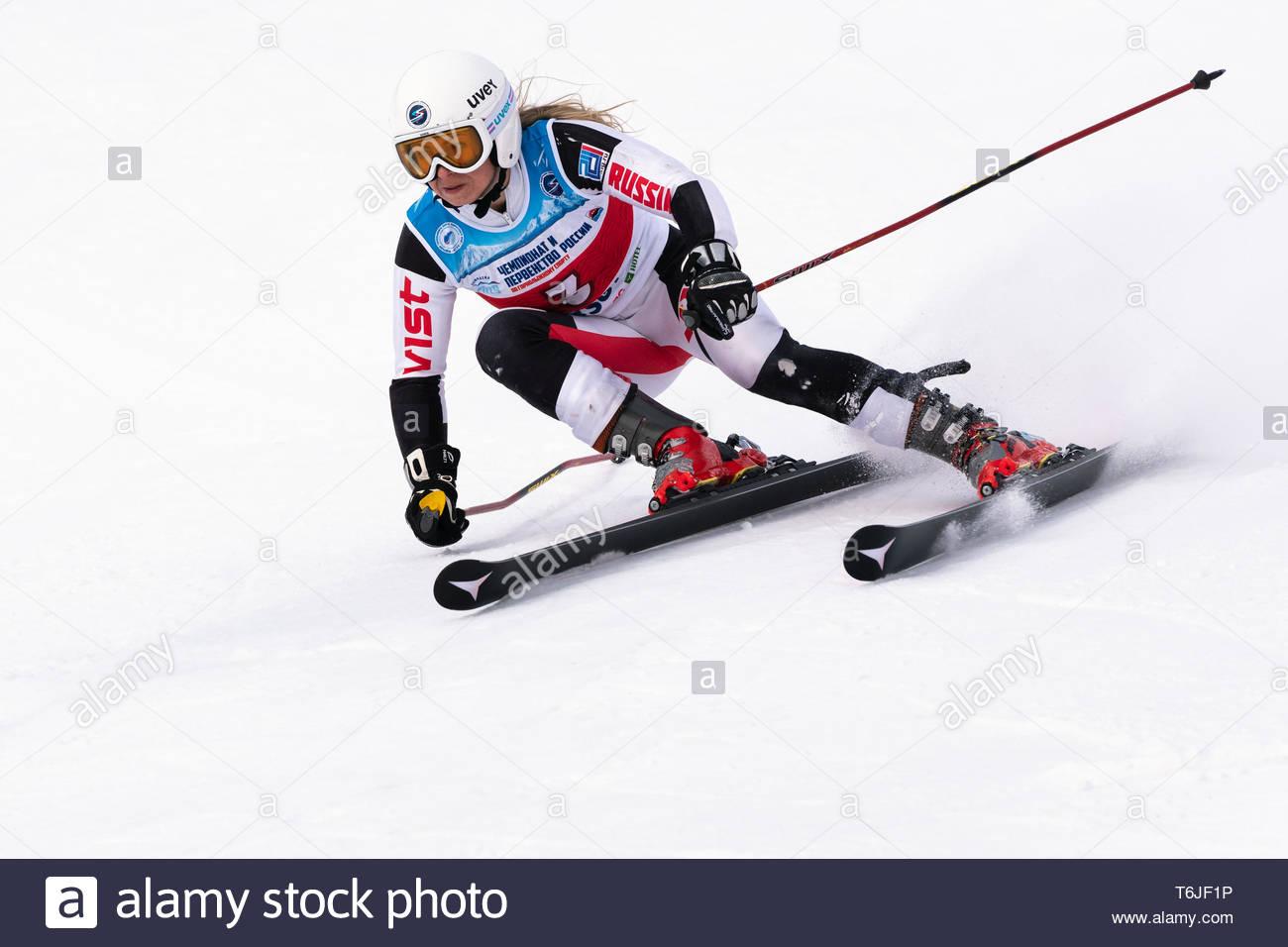 KAMCHATKA PENINSULA, RUSSIA - APRIL 2, 2019: Mountain skier Darya Kolomova (Krasnoyarsk) skiing down mount. International Ski Federation, Championship - Stock Image