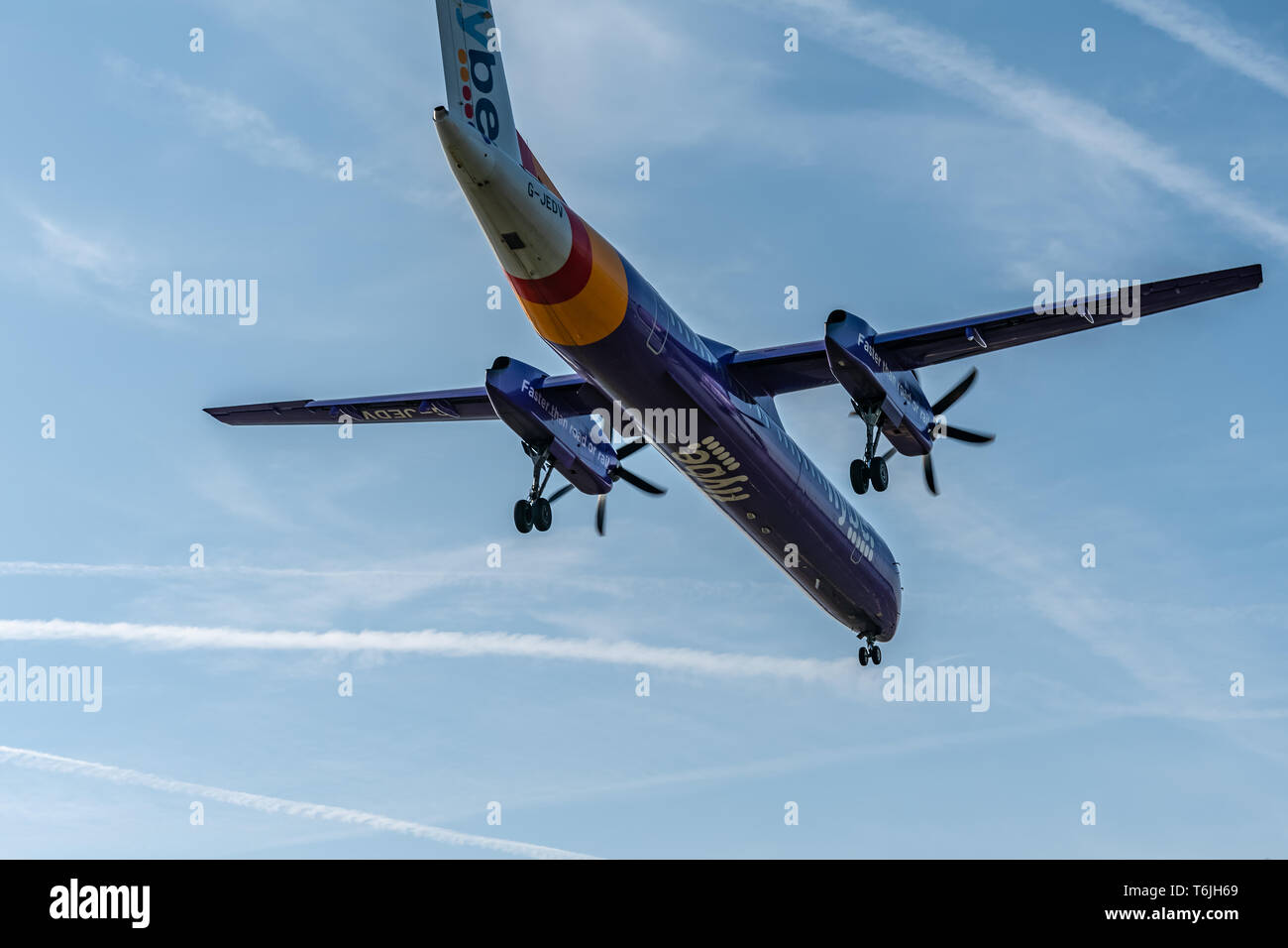 London, UK - 17, February 2019: Flybe a British regional airline based in England, aircraft type De Havilland Canada DHC-8-400 Fly on blue sky. - Stock Image