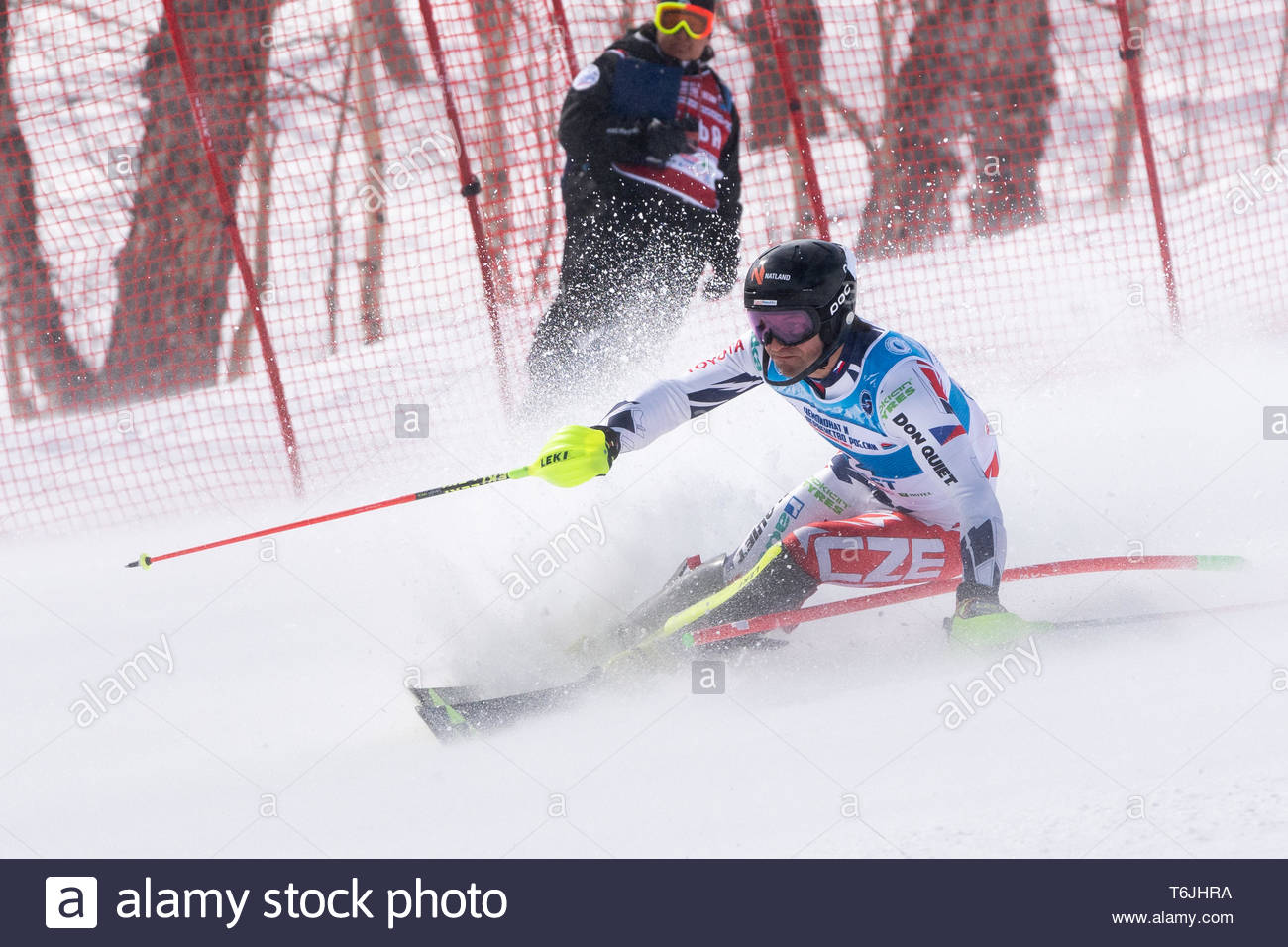 MOROZNAYA MOUNT, KAMCHATKA PENINSULA, RUSSIAN FAR EAST - MARCH 29, 2019: Mountain skier Kryzl Krystof (Czech Republic) skiing down mountain slope. Int - Stock Image