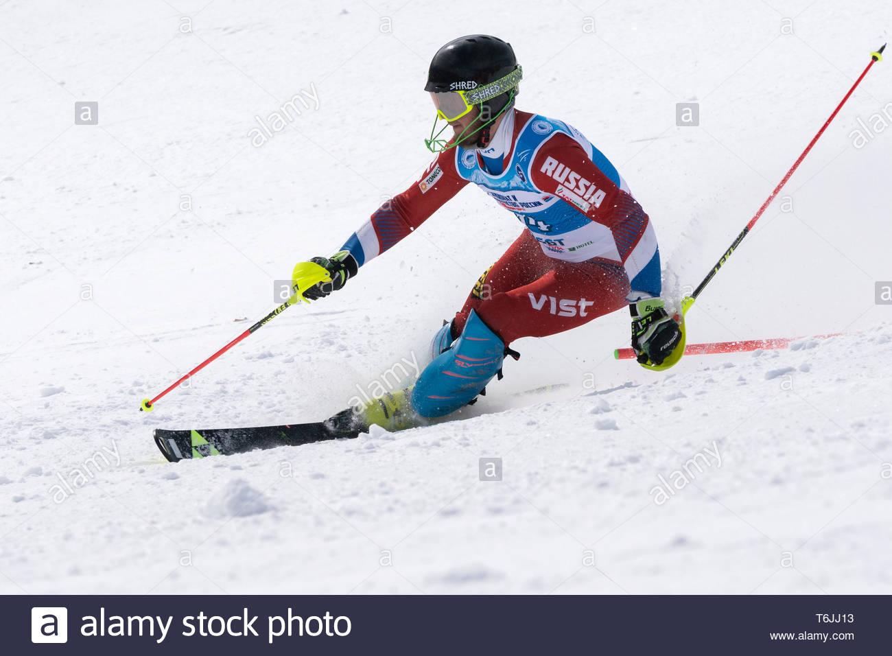 MOROZNAYA MOUNTAIN, KAMCHATKA, RUSSIA - MAR 29, 2019: International Ski Federation Championship, Russian Alpine Skiing Championship slalom. Mount skie Stock Photo