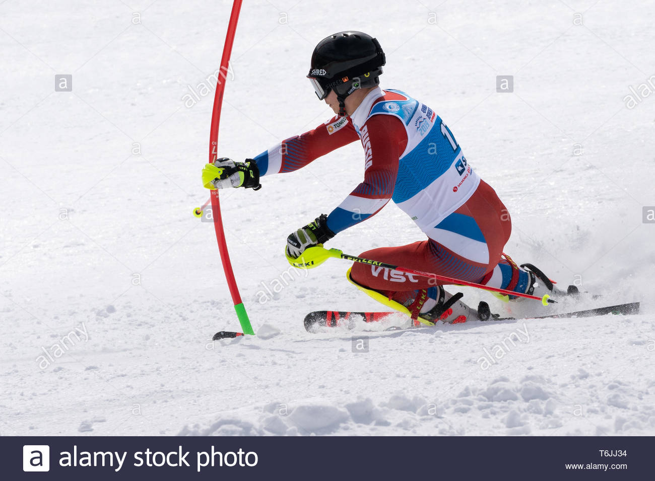 MOROZNAYA MOUNTAIN, KAMCHATKA, RUSSIA - MAR 29, 2019: International Ski Federation Championship, Russian Alpine Skiing Championship, slalom. Mount ski Stock Photo