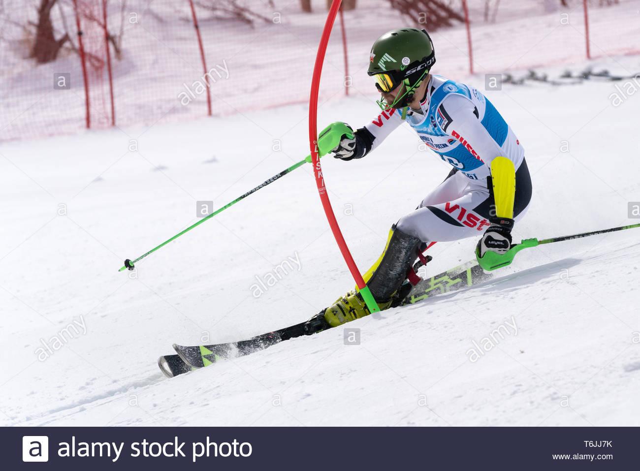 MOROZNAYA MOUNTAIN, KAMCHATKA, RUSSIA - MAR 29, 2019: International Ski Federation Championship, Russian Alpine Skiing Championship, slalom. Mount ski Stock Photo