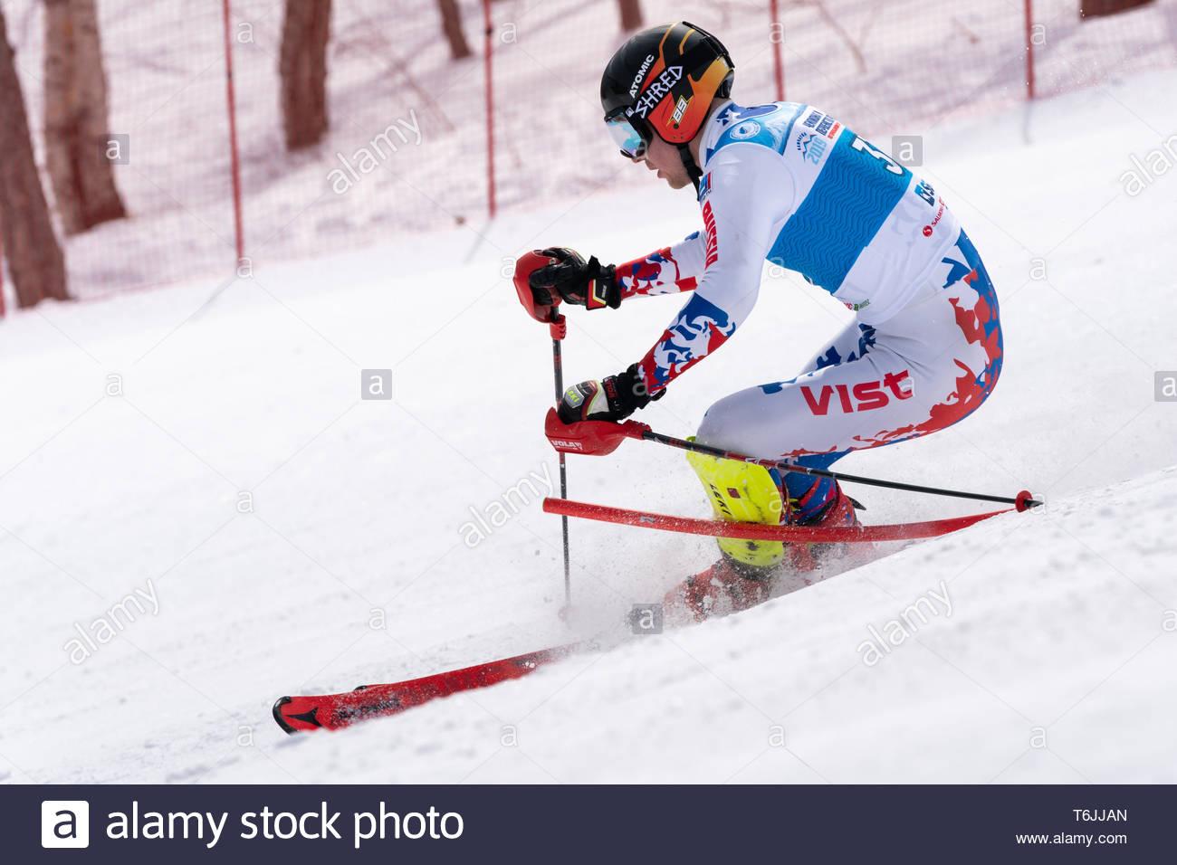 MOROZNAYA MOUNT, KAMCHATKA, RUSSIA - MAR 29, 2019: Russian Alpine Skiing Championship International Ski Federation Championship slalom. Mountain skier - Stock Image