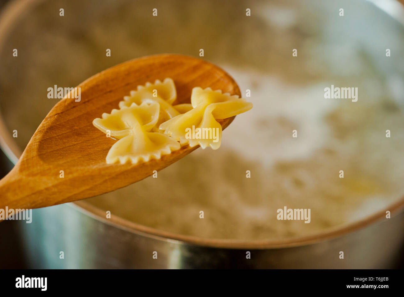 checking the cooking of pasta - Stock Image