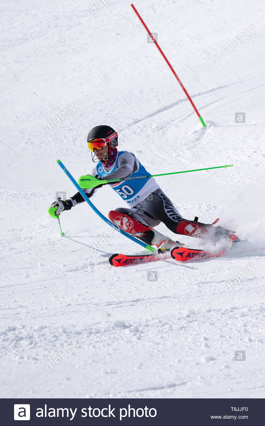 MOROZNAYA MOUNT, KAMCHATKA, RUSSIA - MAR 29, 2019: International Ski Federation Championship, Russian Alpine Skiing Championship, slalom. Mount skier  - Stock Image