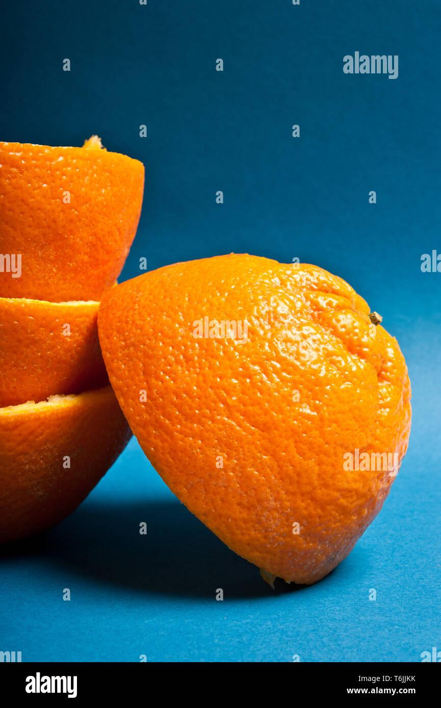 stacked halves of peeled oranges - Stock Image