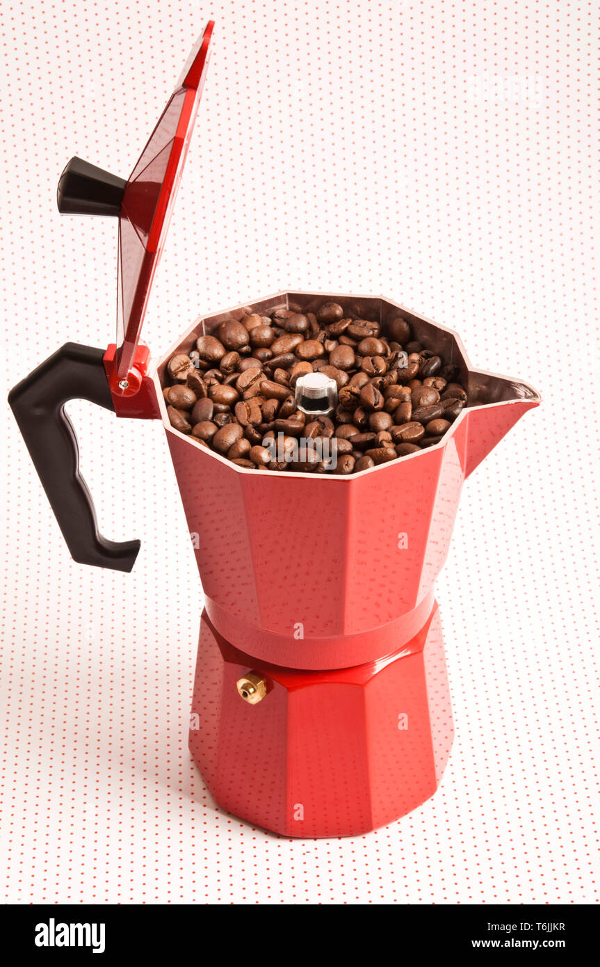 moka pot filled with coffee beans - Stock Image
