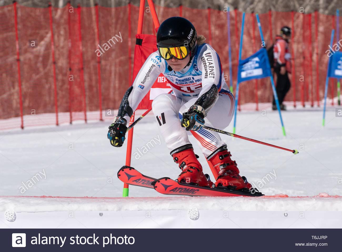 MOROZNAYA MOUNT, KAMCHATKA PENINSULA, RUSSIA - MARCH 30, 2019: Russian Federation Alpine Skiing Championship, parallel slalom. Mount skier Pogrebitska - Stock Image