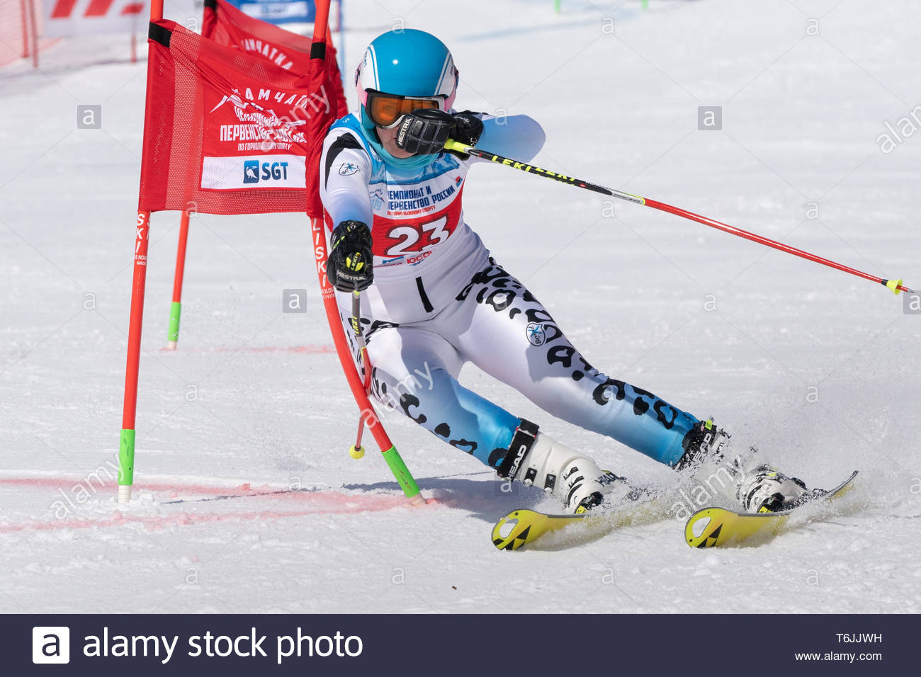 MOROZNAYA MOUNT, KAMCHATKA PENINSULA, RUSSIA - MARCH 30, 2019: Russian Federation Alpine Skiing Championship, parallel slalom. Mountain skier Veronika - Stock Image