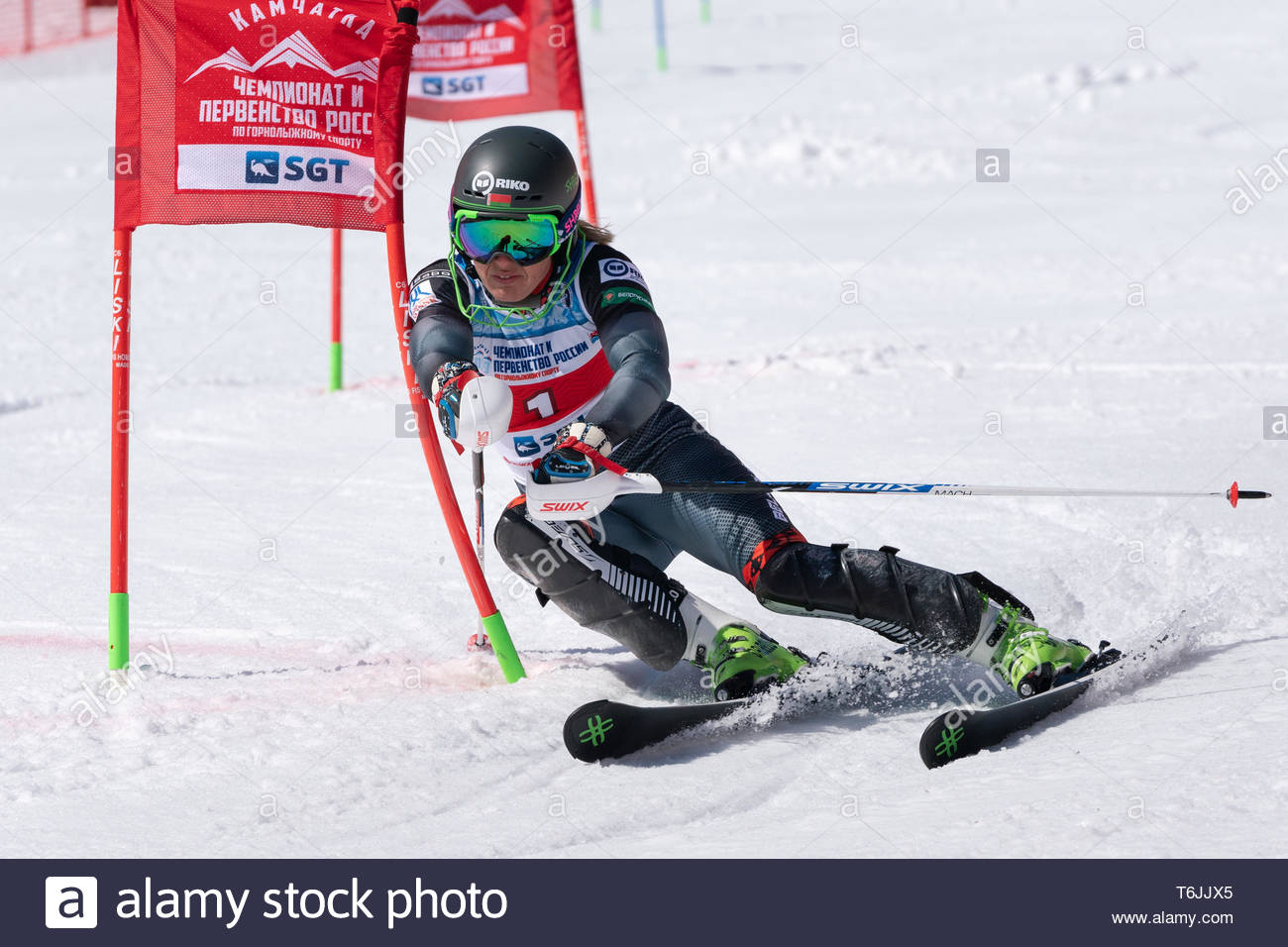 MOROZNAYA MOUNT, KAMCHATKA PENINSULA, RUSSIA - MARCH 30, 2019: Russian Federation Alpine Skiing Championship, parallel slalom. Mountain skier Shkanova - Stock Image