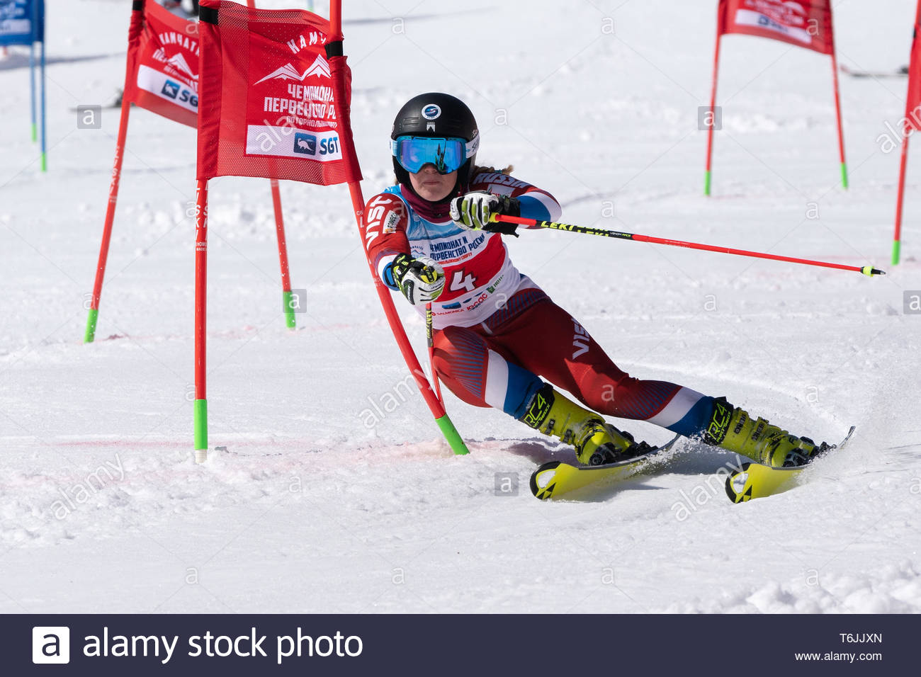 MOROZNAYA MOUNT, KAMCHATKA PENINSULA, RUSSIAN FEDERATION - MAR 30, 2019: Russian Federation Alpine Skiing Championship parallel slalom. Mountain skier - Stock Image