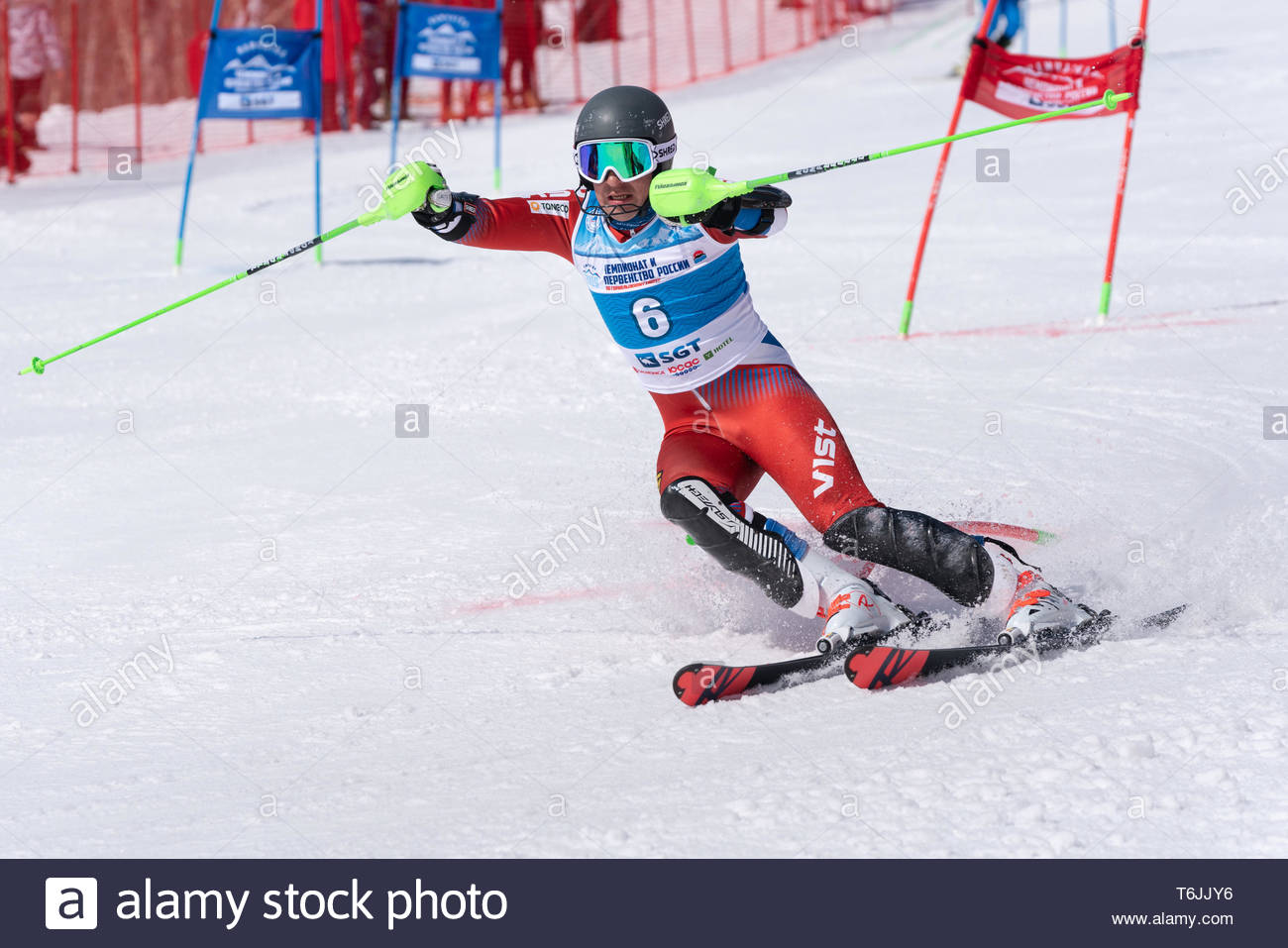 MOROZNAYA MOUNT, KAMCHATKA PENINSULA, RUSSIA - MARCH 30, 2019: Russian Federation Alpine Skiing Championship, parallel slalom. Mountain skier Alexandr - Stock Image