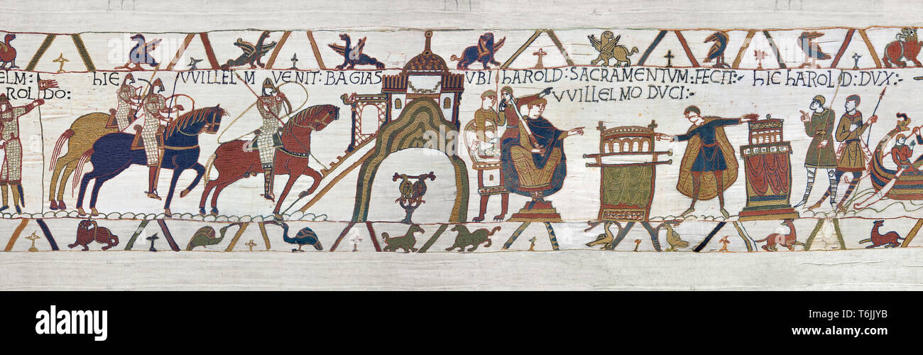Bayeux Tapestry Scene 22 and 23 - Harold and William go to Bayeux where holding two relics Harold swears fealty to Duke William - Stock Image