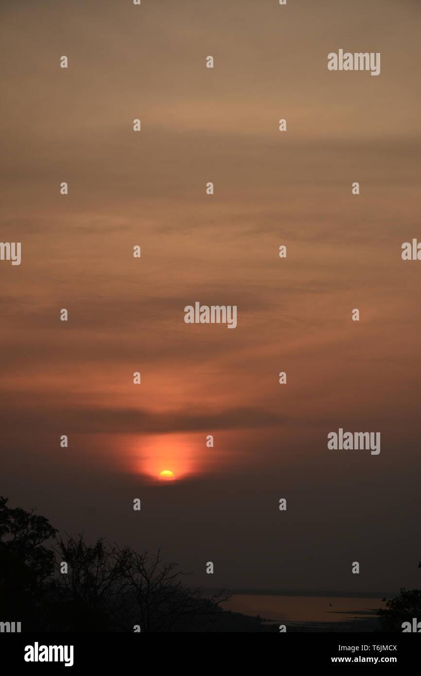 Sunset over Angkor Wat - Stock Image