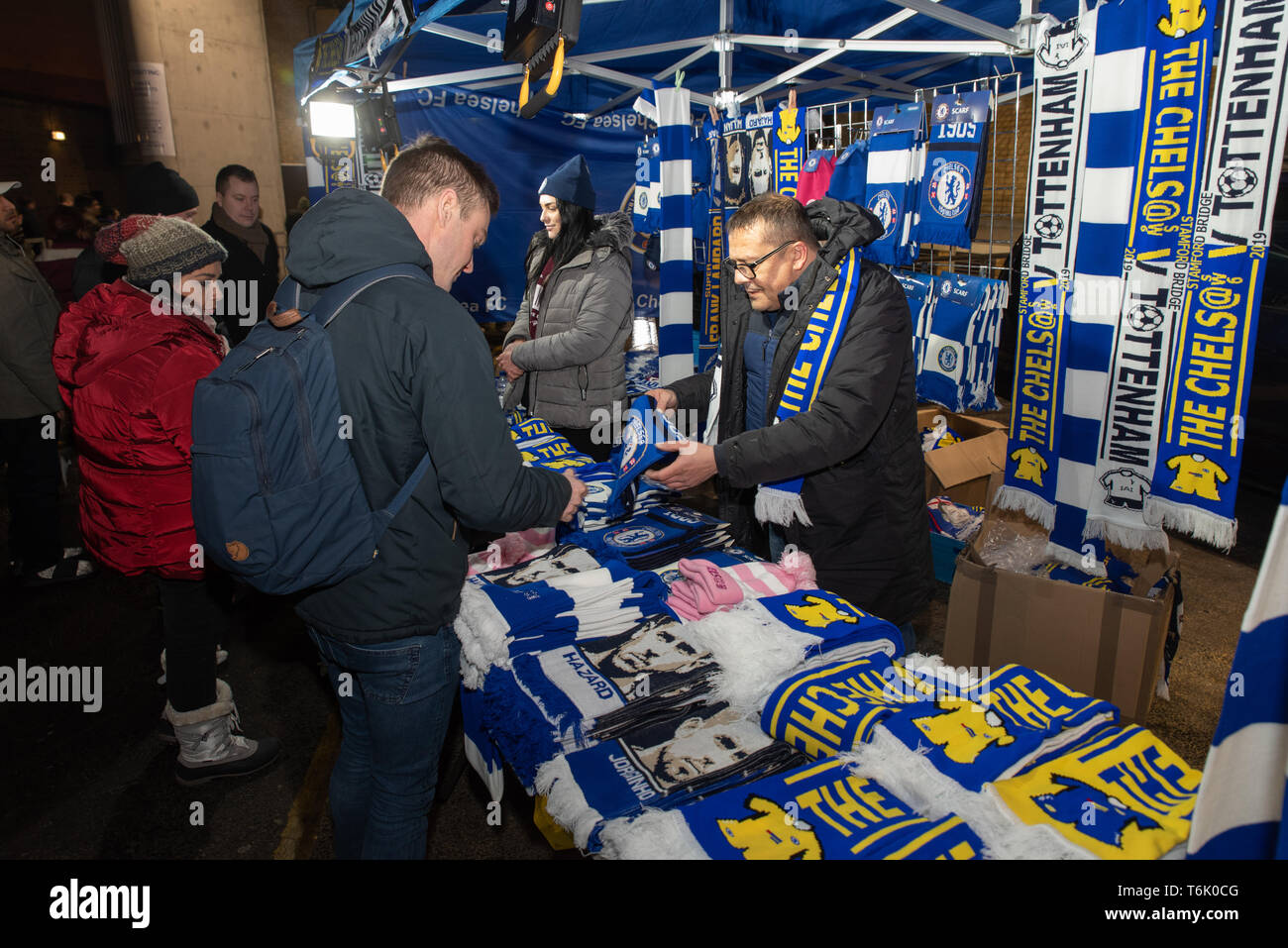 Supporter buying a Chelsea scarf near Stamford Bridge stadium, Chelsea F.C's home. - Stock Image
