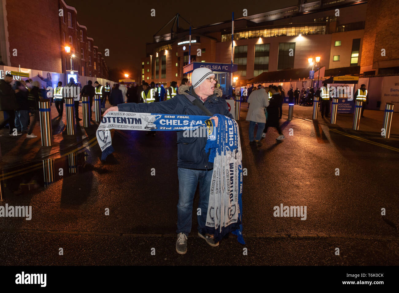Chelsea scarves seller near Stamford Bridge, Chelsea F.C's home ground before a game against Tottenham Hotspur. - Stock Image