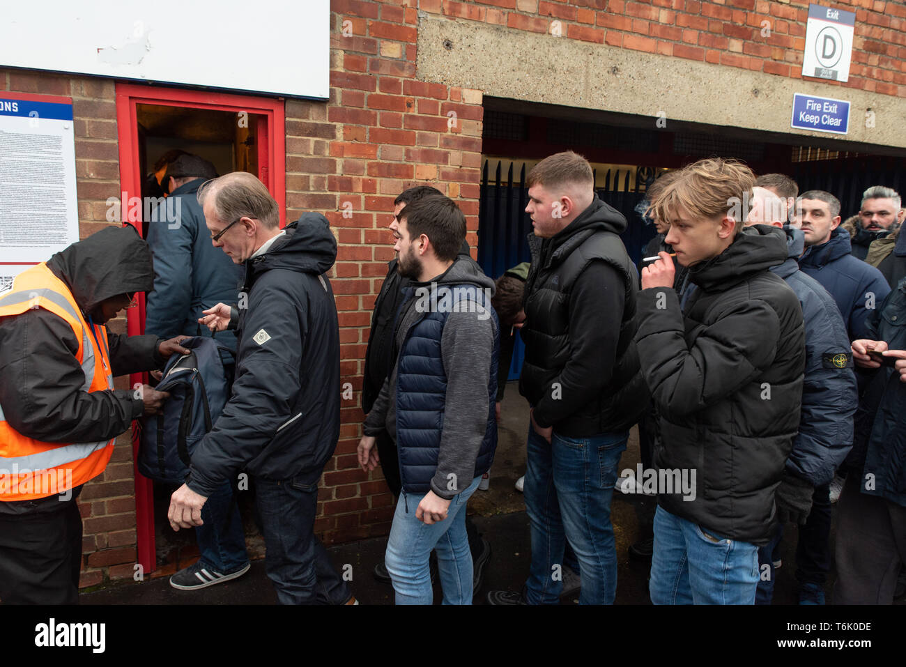 Tottenham Hotspur's fans are searched before entering Selhurst Park for a FA Cup tie against Crystal Palace. - Stock Image