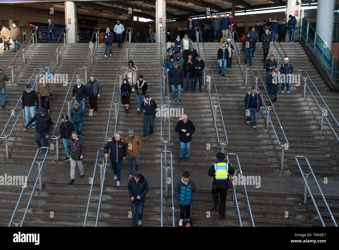 Supporters arriving at Wembley park station for a Premier League game between Tottenham Hotspur and Newcastle F.C. February 2019. - Stock Image