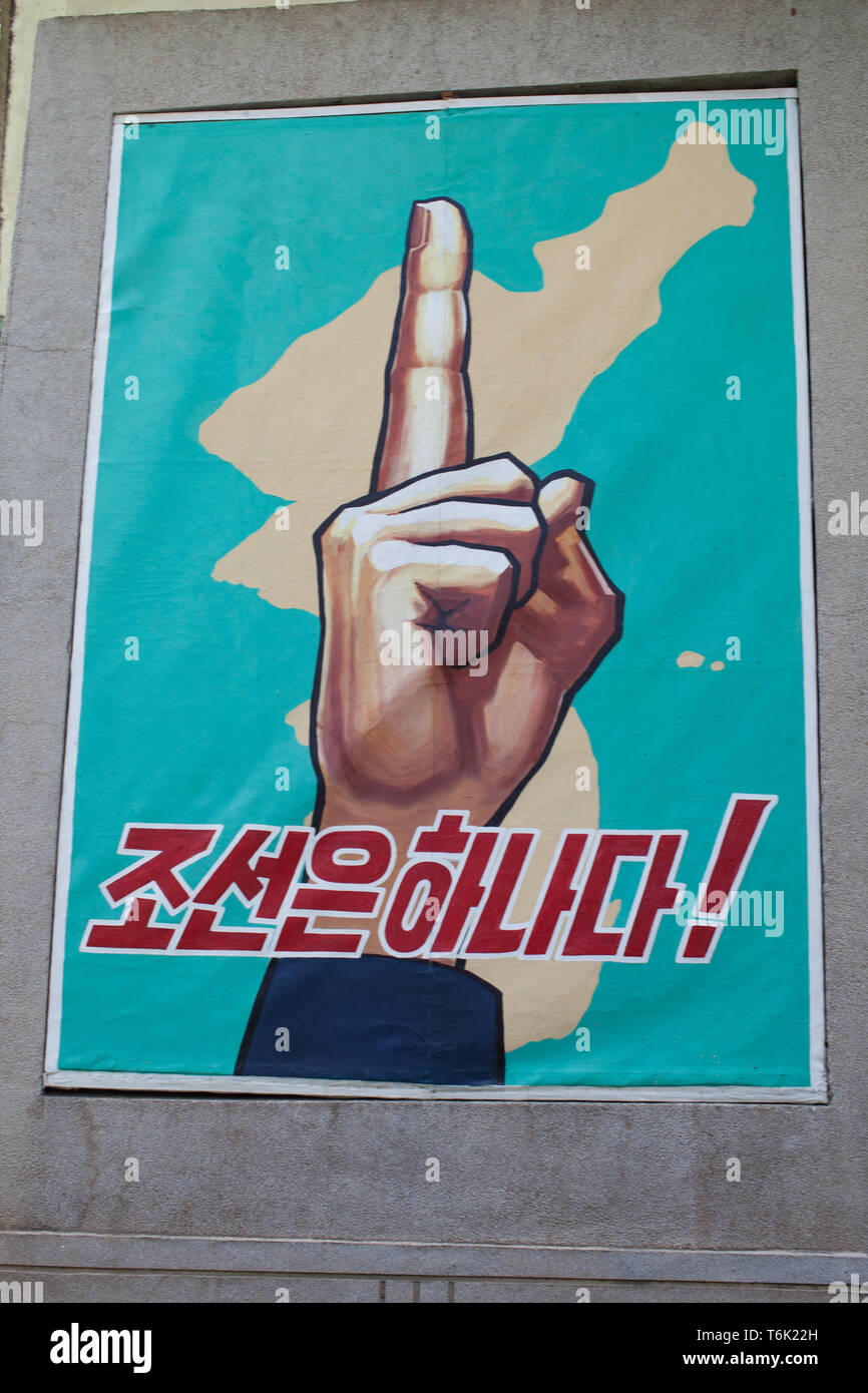 The Songun doctrine is about putting military defence first - this is represented by an uplifted finger. - Stock Image