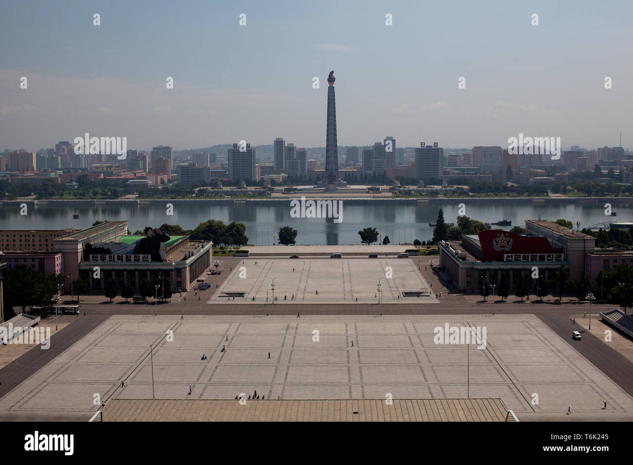The Juche Idea Tower is seen across the Taedong River beyond Kim Il Sung Square in Pyongyang. The backbone of North Korean political philosphy is Juch - Stock Image